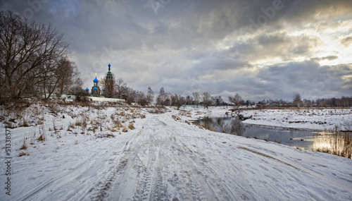 Winter rural landscape with orthodox church