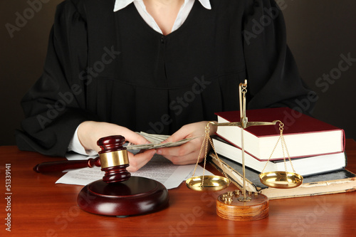 Judge sitting at table during court hearings on black