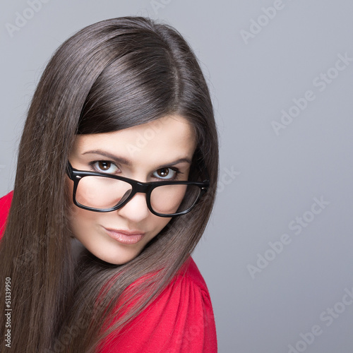 Beautiful businesswoman wearing black nerd glasses