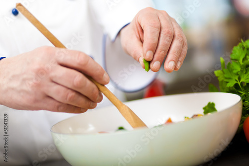 Chef preparing a salad