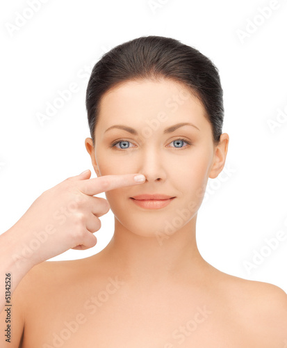 woman touching her nose