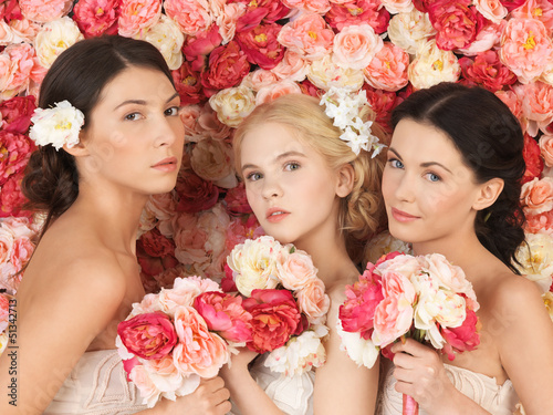 three women with background full of roses