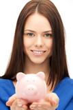 lovely woman with small piggy bank