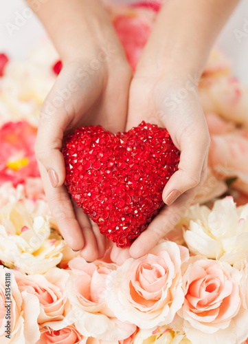 woman's hands holding heart