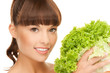 woman holding lettuce