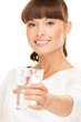 young smiling woman with glass of water