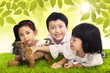 Three siblings and dog in park