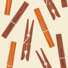 Wooden clothespins on the beige background