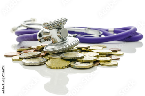 Stethoscope on Euro coins on a white background