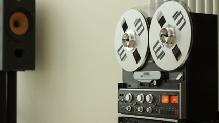 Vintage classic tape reel audio recorder, slow motion