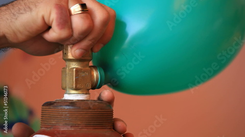 Inflating a balloon with helium. Close-up