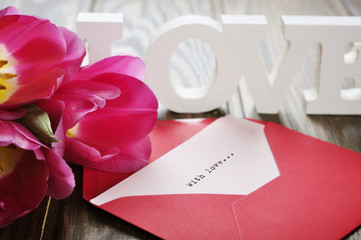 tulips and red open envelope