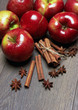 Fresh red apples with cinnamon and anise
