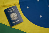 Brazilian passport over a Brazilian flag