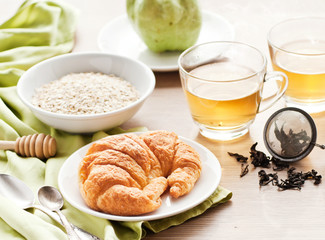healthy breakfast: croissant, porridge and green tea