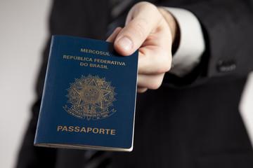 Man presenting a Brazilian Passport.