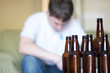 Man looks depressed with empty beer bottles