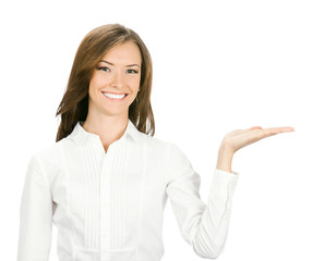 Happy smiling young business woman showing