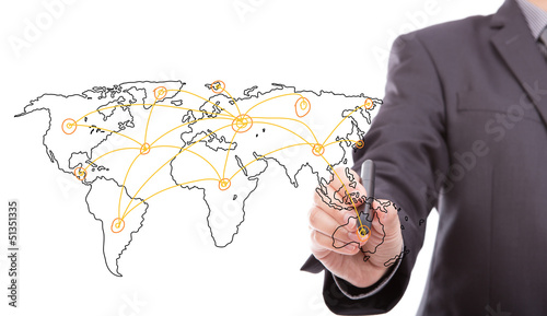 Businessman drawing a world map isolated on a white background
