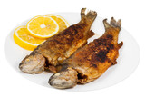 fried river trout fish on plate