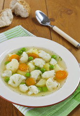 Vegetable soup with cauliflower and green peas