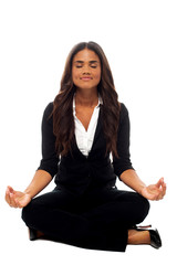 Businesswoman meditating in lotus posture