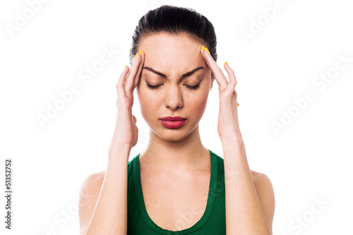 Asian woman having headache