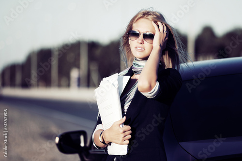 Young businesswoman holding financial papers