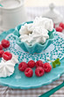 Fresh raspberries and sweet meringues