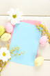 Empty card with easter eggs and mimosa flowers,