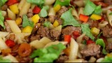 Minced meat with pasta and vegetables on a pan
