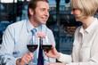 Happy couple toasting red wine