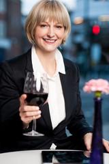 Happy businesswoman holding wine glass