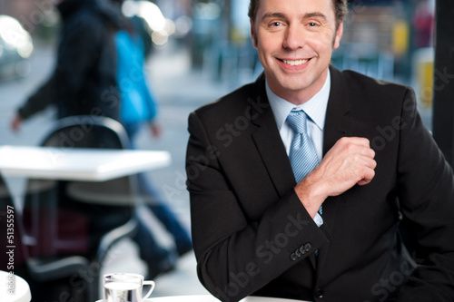 Handsome cheerful experienced businessman