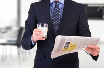 Businessman with glass of milk.