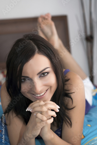 Beautiful brunette laughs