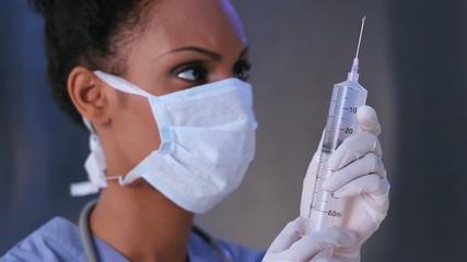 Nurse and big needle.