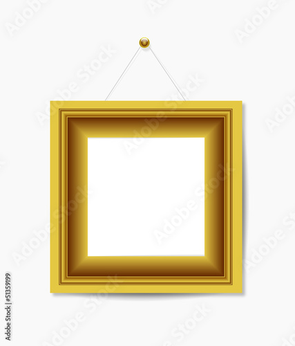 Gold picture frame hanging on white