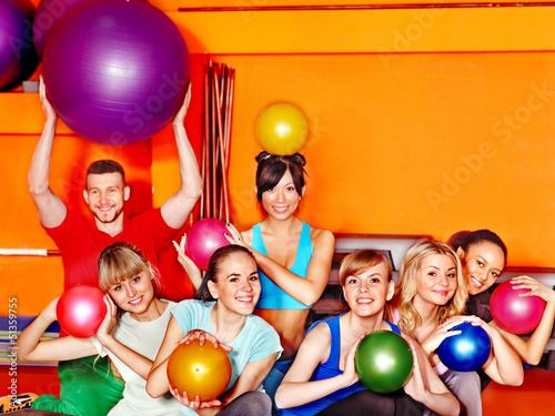 Group people in aerobics class.