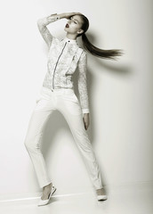 Futuristic Woman in White Trousers. Trend. Series of Photos