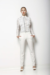 High Fashion. Trendy Woman in White Breeches. Spring Collection