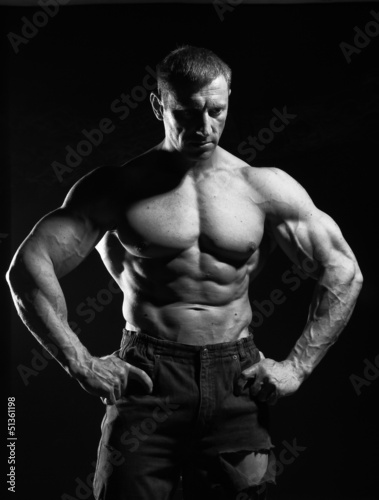 Muscled man in dark trousers