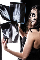 Skull faced girl with x-ray pictures