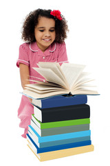 Active kid reading a book and learning