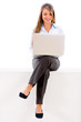 Businesswoman sitting with a laptop