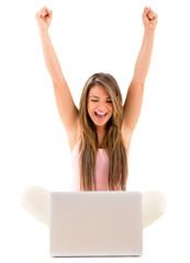 Woman with a laptop celebrating
