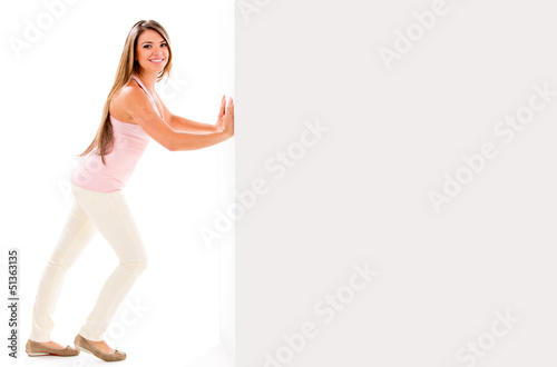 Woman pushing a wall