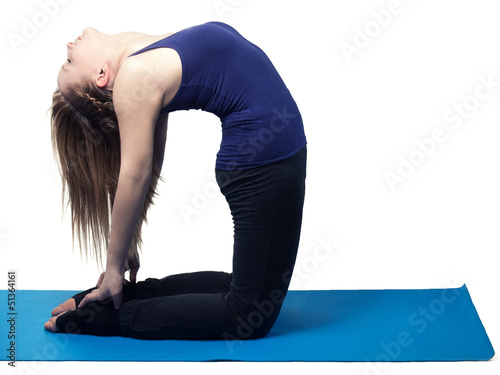young woman yoga exercise the camel - isolated