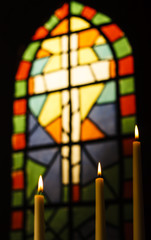 Prayer Candles And Stained Glass Church Window