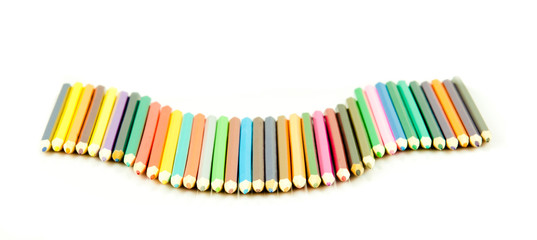 Colour pencils isolated on white background.  Many different col